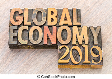 global economy 2019 word abstract in wood type