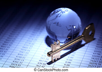 Global Economy - Business concept. Glass globe near key on...