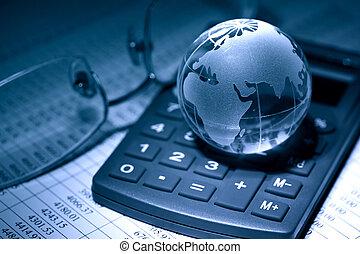 Global Economy - Business concept. Glass globe on calculator...