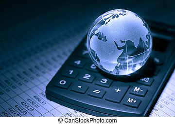 Global Economy - Financial concept. Glass globe on...
