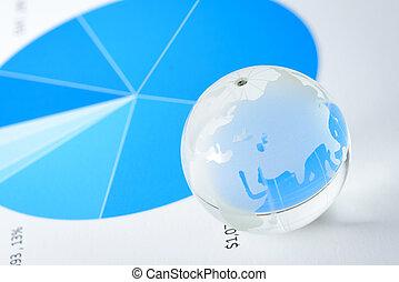 Global economy - Glass world globe rest on financial sheet