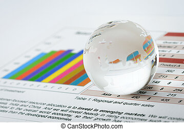 Global economy - Glass world globe rest on financial sheet