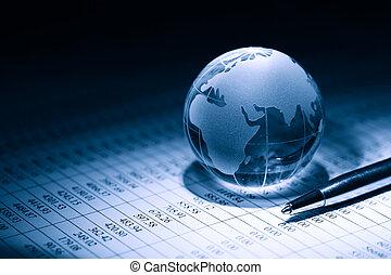 Global Economy - Business concept. Glass globe near pen on...