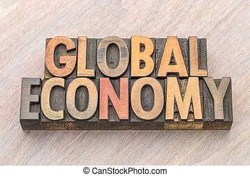 global economy word abstract in wood type