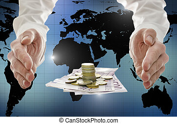 Male hands around Euro coins and banknotes with interactive map of the world in background. Concept of global financial crisis.