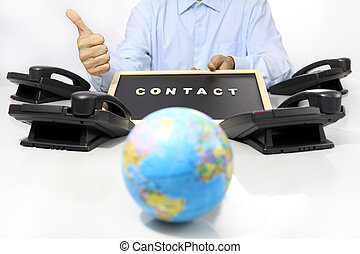 global international contact concept, hand like with office phone on desk and globe map