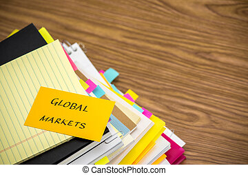 Global Markets; The Pile of Business Documents on the Desk