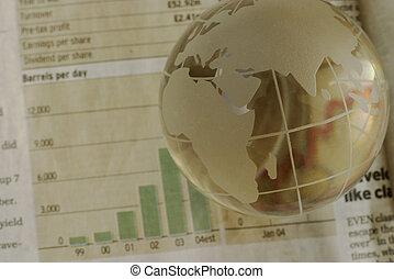 Global oil - Globe in focus, oil chart blurred. Rising trend...