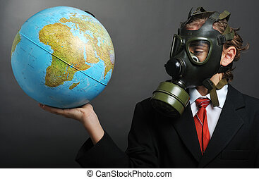 Global pollution - Businessman with gas mask on face holding...