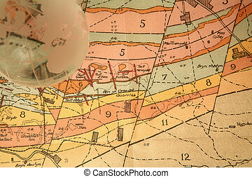 Global survey - Glass globe on 1920s Geological map of part...