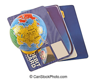 Global transactions - Debit and credit cards with a globe on...