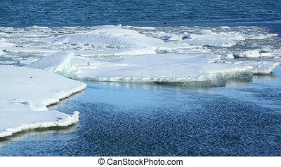 Global warming at a glacier lagoon - Ice blocks melting at...