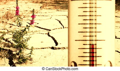 Global warming concept - Arid cracked ground and overheated...