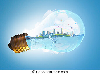 Global warming concept - Glass light bulb with water and ...