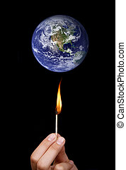 Global warming concept: match stick burning the world
