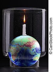 cover burning candle with a glass bottle