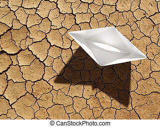 Global warming - paper boat on dry ground