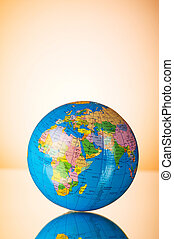 Globalisation concept - globe against gradient colorful background