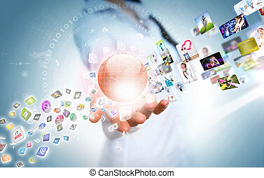 Woman holding illustration of globe in hand. Media technologies