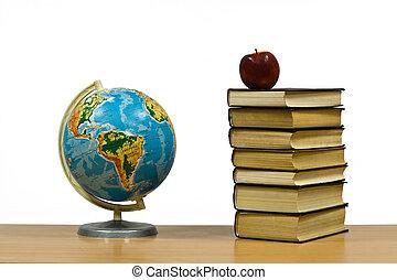 globe, apple and books