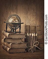 globe, boekjes , stapel