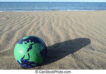 Globe Earth on the Beach