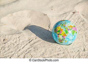 Globe Earth on the Beach near Ocean