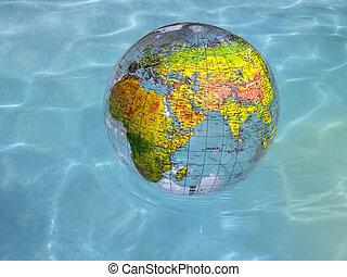 Globe floating on water - A world globe showing Europe, ...