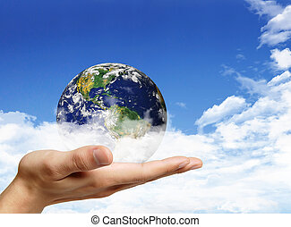 Globe in human hand against blue sky. Environmental protection concept