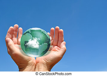 Globe in Human Hands against Sky