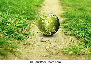 globe in the green  with a path