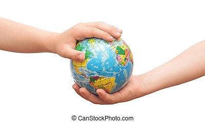 globe in the hands of children.