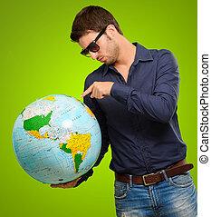 globe, jeune, pointage, homme