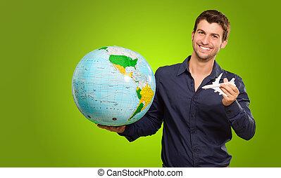 globe, jonge, miniatuur, vasthouden, vliegtuig, man
