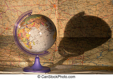 Globe on a map of