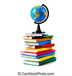 Globe on books isolated over white background