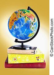 Globe on books