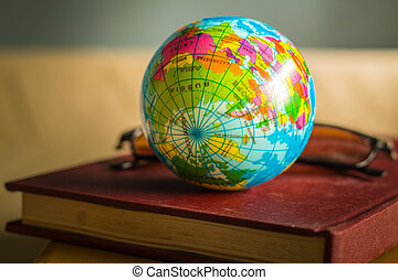 Globe on the cover of an old book