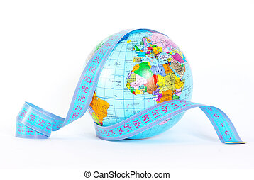 globe on white - Measuring tape stretched across globe on...