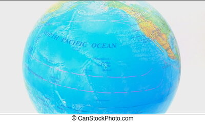 Globe Rotates Close Up on White Bac