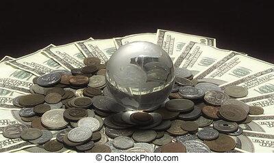 Globe rotates over money