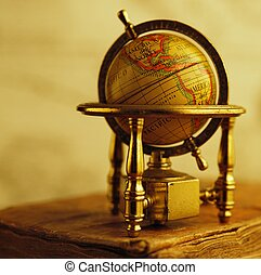 Globe standing on a vintage book.