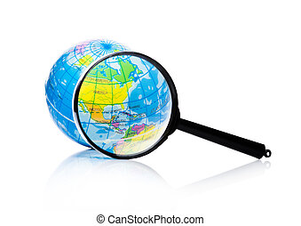 Globe under magnifying glass Amercia and Mexico