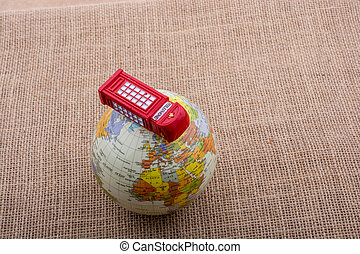 Globe with a telephone booth canvas background