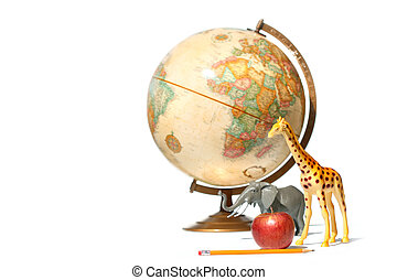 Globe with toy animals and apple on white