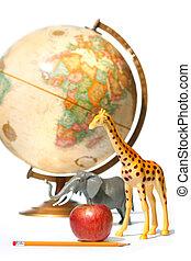 Globe with toys animals on white background