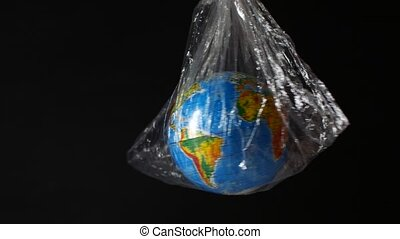 Globe wrapped in polyethylene. Symbolizes delivering packages, transportation, shipping and e-commerce.