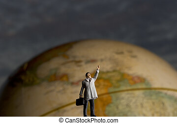 globetrotter - Business figurine placed with antique earth ...