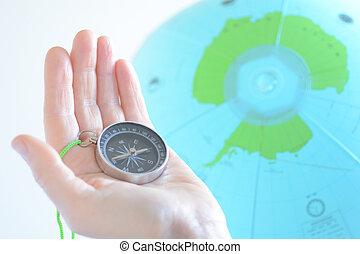 globo, compasso, antártica, segurando mão