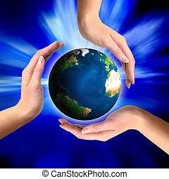 globo de la tierra, manos